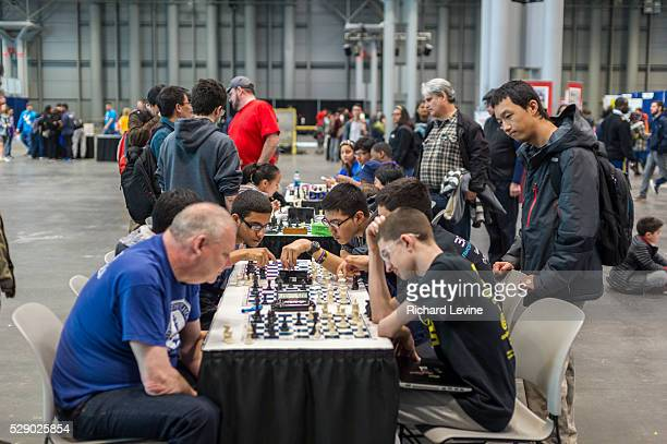 Participants play chess during a break at the FIRST Robotics NYC Championship at the Jacob Javits Convention Center in New York on Sunday March 13...
