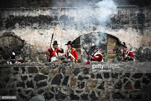 Participants playing the role of British soldiers take part in a historical reenactment of a battle between Spanish and British troops held 220 years...