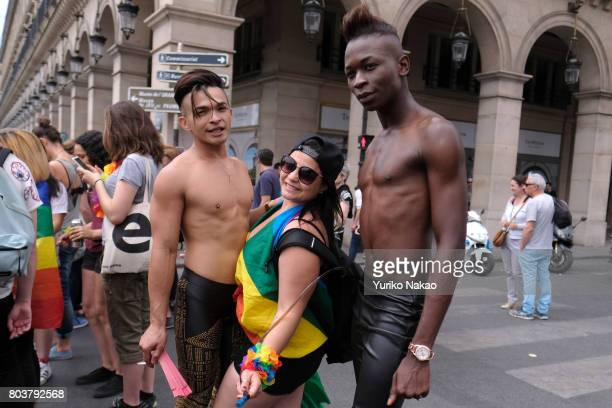 Participants poses for a photograph during the Paris Gay Pride Parade or known as Marche des Fiertés LGBT in France on June 24 2017 in Paris France
