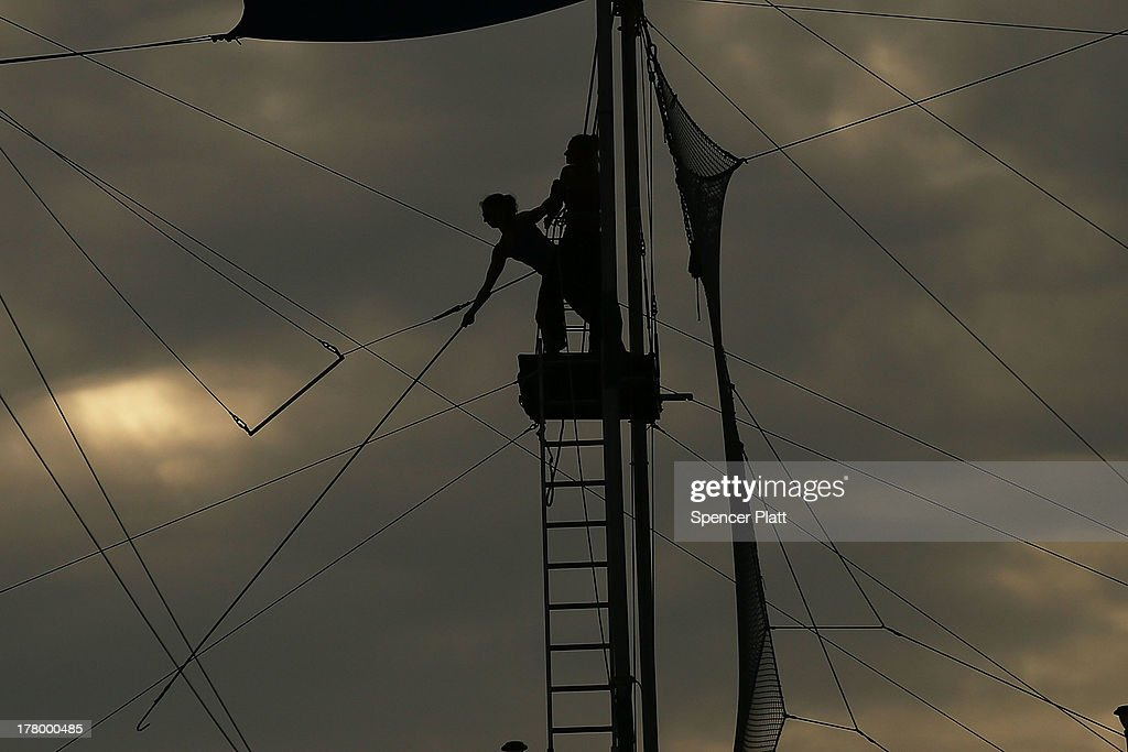 Participants practice on a trapeze at the Trapeze School of New York on the West Side of Manhattan beside the Hudson River on August 26, 2013 in New York City. Over recent years, much of the West Side of Manhattan along the river has been re-developed into parks, restaurants and walking paths.
