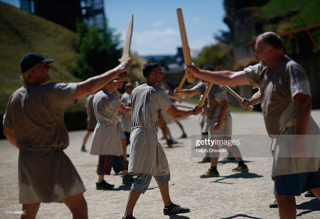 Participants practice sword fighting during a one-day course at the Gladiator School in the Roman-era amphitheater on July 20, 2013 in Trier, Germany. The Gladiator School, launched by German actor Jan Krueger in 2011, seeks to teach not only the fighting skills of the gladiators of ancient Rome, but also the philosophy behind the gladiator ethos. The school offers a variety of classes, including one and three-day courses.