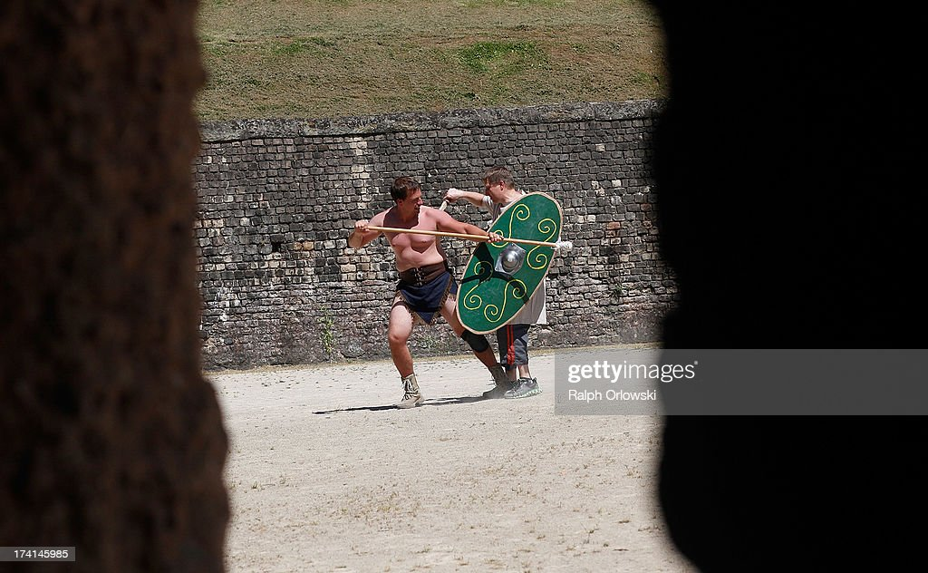 Participants practice their fighting skills during a one-day course at the Gladiator School in the Roman-era amphitheater on July 20, 2013 in Trier, Germany. The Gladiator School, launched by German actor Jan Krueger in 2011, seeks to teach not only the fighting skills of the gladiators of ancient Rome, but also the philosophy behind the gladiator ethos. The school offers a variety of classes, including one and three-day courses.
