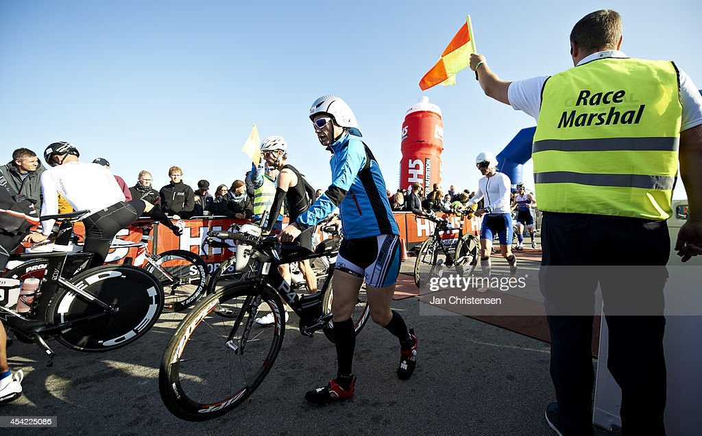 Participants prepare for cycling during KMD Ironman Copenhagen on August 24, 2014 in Copenhagen, Denmark.