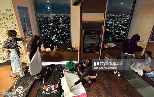 Participants prepare sleeping bags during the overnight staying event at the observation deck of the Sunshine 60 building on May 2 2015 in Tokyo...