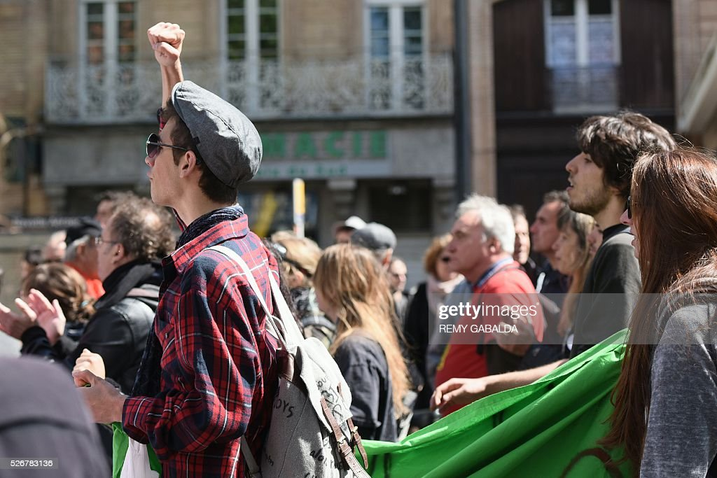 Participants protest against the government's proposed labour law reforms during the traditional May Day demonstration in Toulouse, southern France, on May 1, 2016. / AFP / REMY