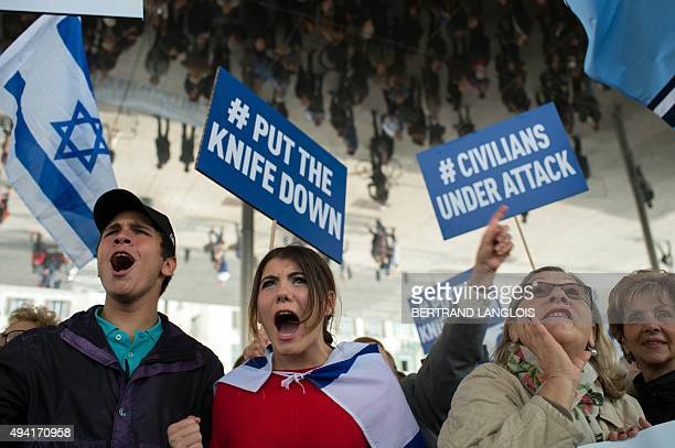 Participants protest with placards reading 'Put the knife down' and 'Civilian under attack' in Marseille southern France on October 25 against a...