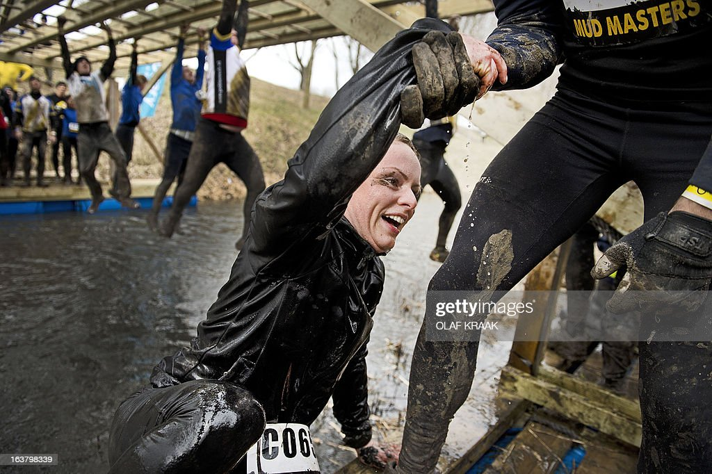 Participants race in the annual Masters Obstacle Mud Run in Vijfhuizen, Netherlands, on March 16, 2013. Thousands of sporty runners braved the mud trail with difficult obstacles constructed by Dutch Marines. AFP PHOTO/ ANP / OLAF KRAAK netherlands out