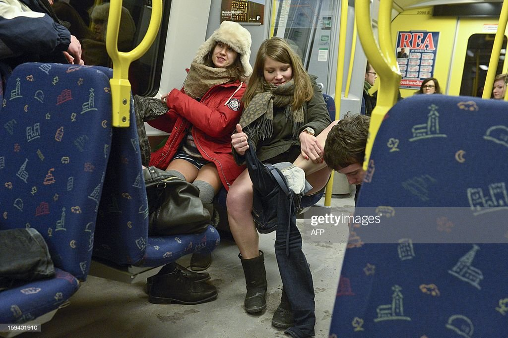 Participants rake off their clothes to take part in the annual 'No Pants Subway Ride' in Stockholm, on January 13, 2013. The yearly prank, organized by New York City-based prank collective Improv Everywhere was started in 2002, asking participants to ride subway lines pants-free and act straight-faced about it. AFP PHOTO / JANERIK HENRIKSSON /SCANPIX SWEDEN/ SEDEN OUT