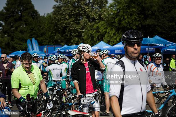 Participants relax after ride a bike part at the 8th Garmin Velothon on May 31 2015 in Berlin Germany Ten thousand bike enthusiasts drove routes with...