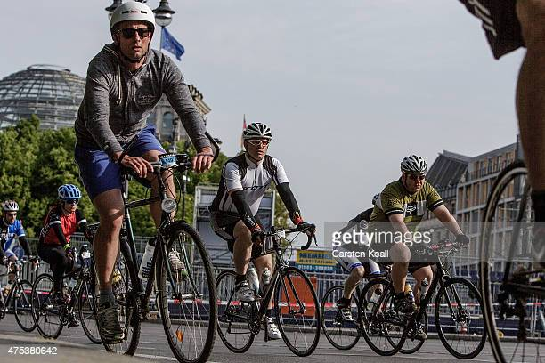 Participants ride a bike part at the 8th Garmin Velothon passing the landmark German Parliament in the Reichstag building on May 31 2015 in Berlin...