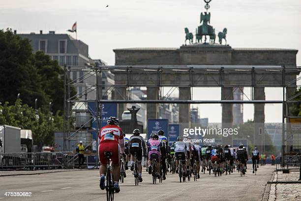 Participants ride a bike part at the 8th Garmin Velothon passing the landmark Brandenburger Tor on May 31 2015 in Berlin Germany Ten thousand bike...