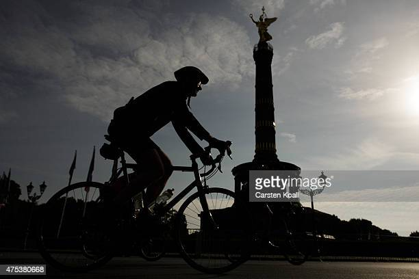 Participants ride a bike part passing the Landmark Victory Column at the 8th Garmin Velothon on May 31 2015 in Berlin Germany Ten thousand bike...