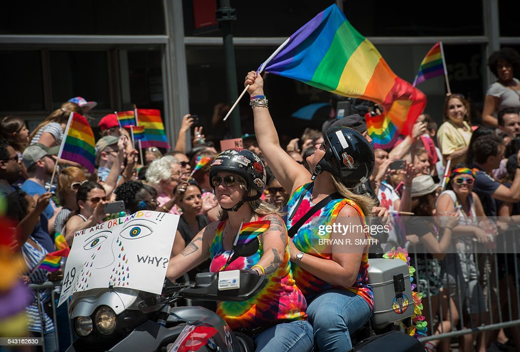 Participants ride a motorcycle during the 46th annual Gay Pride march June 26, 2016 in New York. New York kicked off June 26 what organizers hope will be the city's largest ever Gay Pride march, honoring the 49 people killed in the Orlando nightclub massacre and celebrate tolerance. / AFP / the 46th / Bryan R. Smith