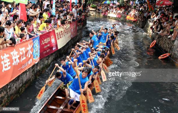 Participants row dragon boats as they compete in a race during Dragon Boat Festival celebrations on June 2 2014 in Foshan China The Dragon Boat...