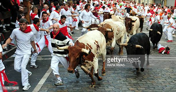 Participants run alongside Fuente Ymbro fighting bulls on the third San Fermin Festival bull run on July 9 in Pamplona northern Spain The festival is...