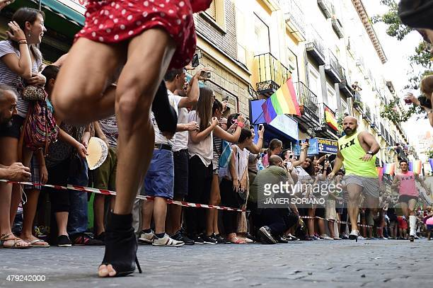 Participants run as they take part in the 'High Heels Race' in Madrid on July 2 2015 The annual high heel race in Madrid gathers a crowd to witness...