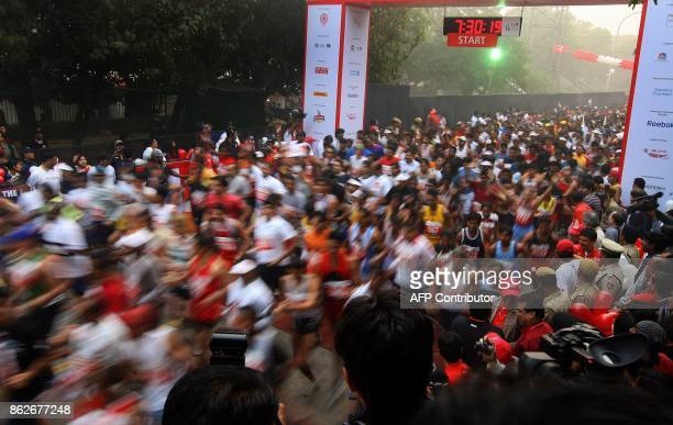 Participants run at the start of the Delhi Half Marathon in New Delhi on November 9 2008 Ethiopian athletes Deriba Merga and Aselefech Mergia won the...