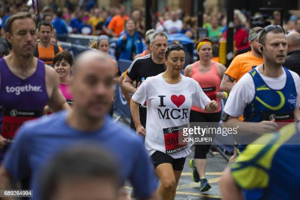 Participants run at the start of the Great Manchester Run in Manchester on May 28 2017 Britain police have released CCTV footage of Manchester bomber...