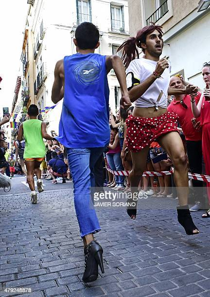 Participants run during the 'High Heels Race' in Madrid on July 2 2015 The annual high heel race in Madrid gathers a crowd to witness participants...