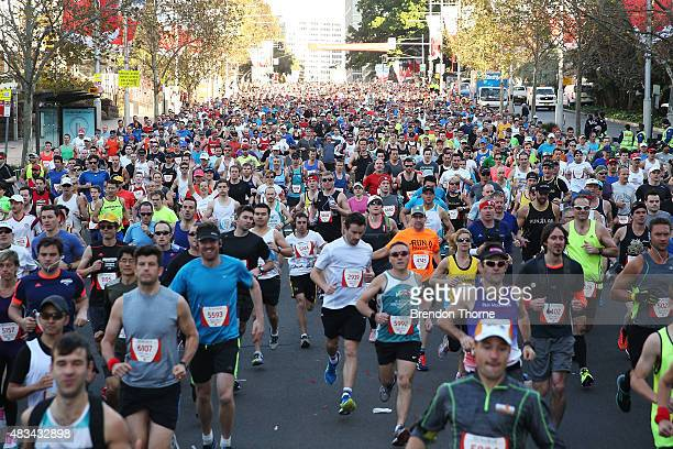 Participants run during the start of the 2015 City To Surf race on August 9 2015 in Sydney Australia