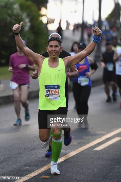 Participants run during the United Airlines Guam Marathon 2017 on April 9 2017 in Guam Guam