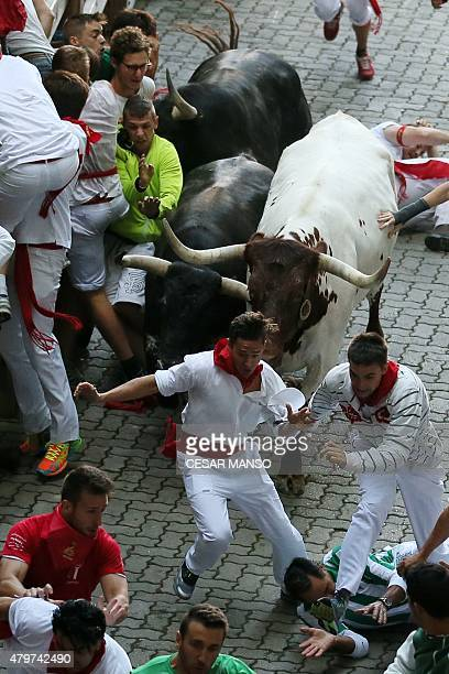Participants run in front of Jandilla bulls during the first 'encierro' of the San Fermin Festival in Pamplona northern Spain on July 7 2015 The...