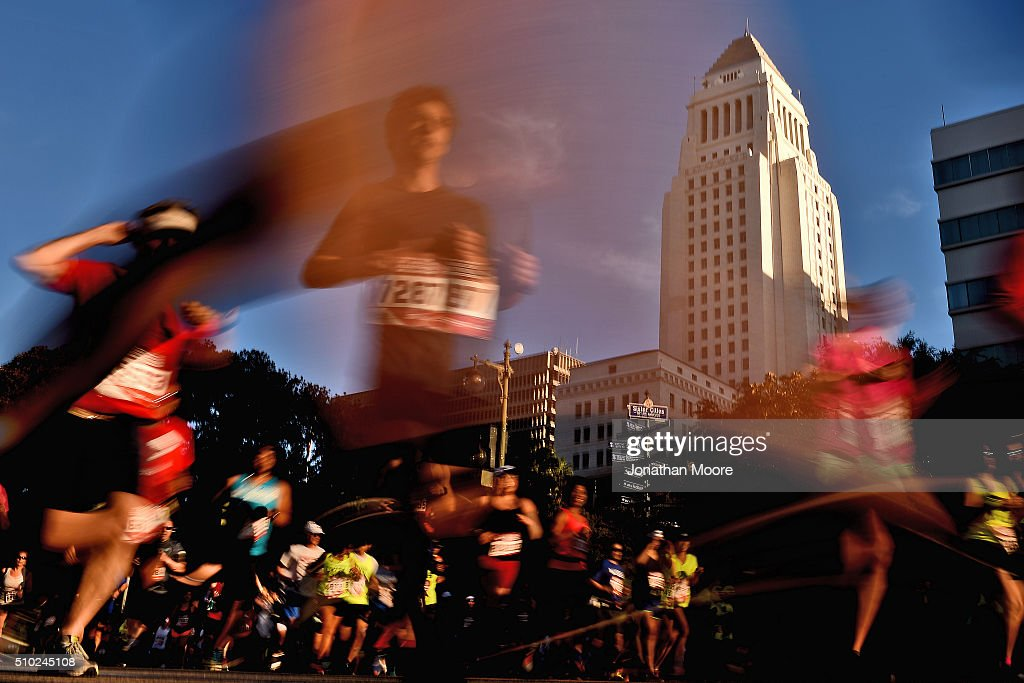 Participants run near Los Angeles City Hall during the 2016 Skechers Performance Los Angeles Marathon on February 14, 2016 in Los Angeles, California.