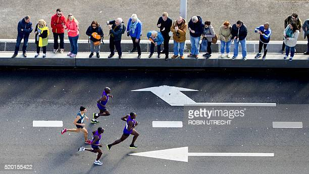 Participants run on the Erasmus bridge during the Rotterdam Marathon in Rotterdam on April 10 2016 / AFP / ANP / Robin Utrecht / Netherlands OUT