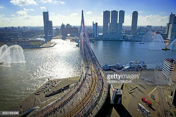 Participants run on the Erasmus bridge during the Rotterdam Marathon in Rotterdam on April 10 2016 / AFP / ANP / Robin Utrecht / Netherlands OUT