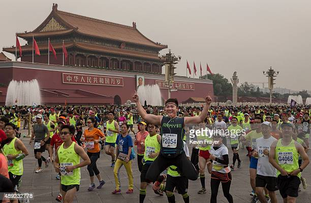 Participants run passed Tiananmen Gate while competing in the 2015 Beijing Marathon on September 20 2015 in Beijing China Thousands of runners from...