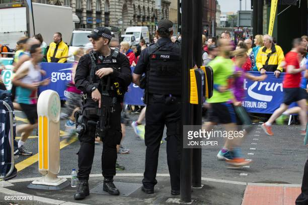 Participants run past armed police at the start of the Great Manchester Run in Manchester on May 28 2017 Britain police have released CCTV footage of...