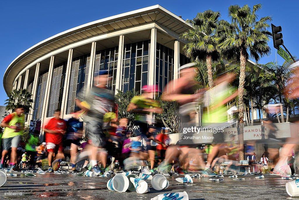 Participants run past the Dorothy Chandler Pavilion and the Los Angeles Music Center during the 2016 Skechers Performance Los Angeles Marathon on February 14, 2016 in Los Angeles, California.