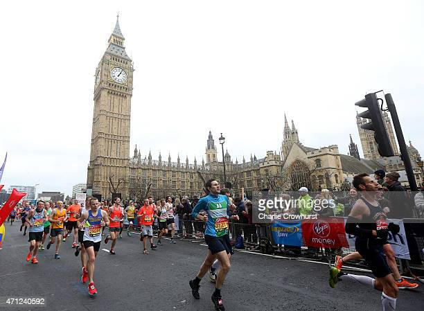 Participants run past the Houses of Parliament during the Virgin Money London Marathon 2015 on April 26 2015 in London England