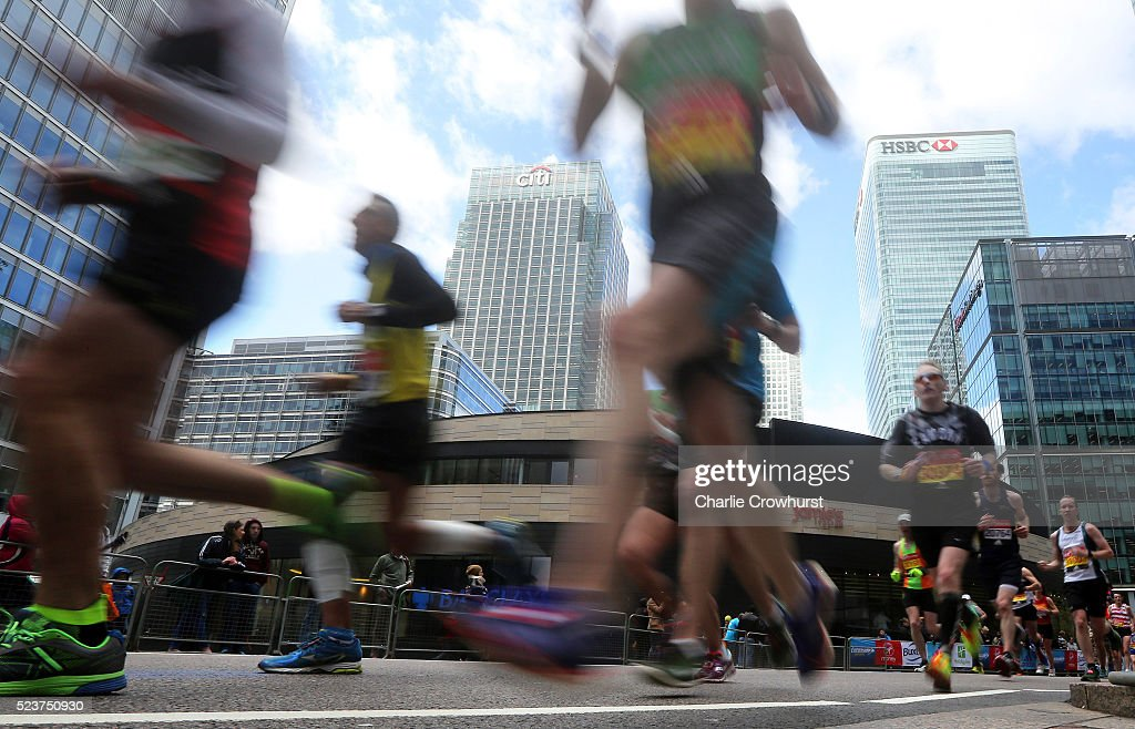 Participants run through Canary Wharf during the 2016 Virgin Money London Marathon on April 24, 2016 in London, England.
