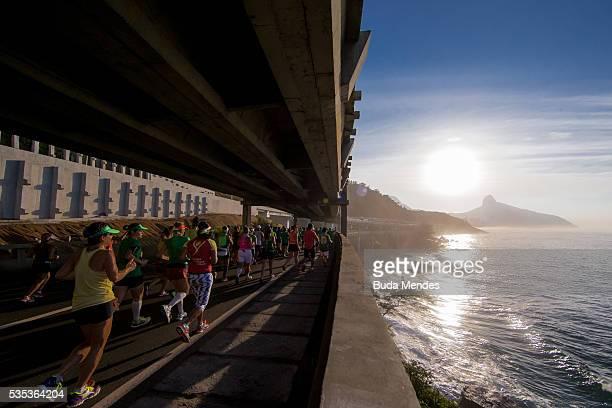 Participants run through Elevado do Joa during the Rio de Janeiro Marathon on May 29 2016 in Rio de Janeiro Brazil