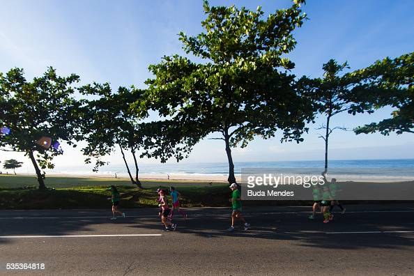 Participants run through Sao Conrado during the Rio de Janeiro Marathon on May 29 2016 in Rio de Janeiro Brazil