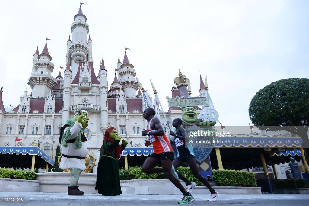 Participants run through Universal Studios Singapore during the Singapore Standard Chartered Marathon on December 1, 2013 in Singapore.