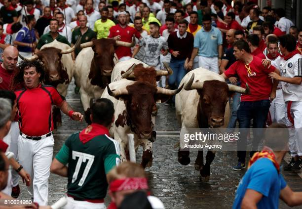 Participants run with fighting bulls during the San Fermin festival on July 08 2017 in Pamplona Spain The San Fermin Festival is held annually from...