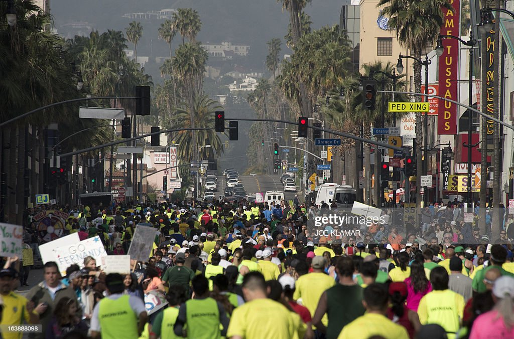 Participants running down Hollywood boulevard during the annual Asics LA Marathon on March 17, 2013 in Hollywood , California. The marathon, attended by over 24 thousand participants, started at Dodger's stadium in Los Angeles and finished in Santa Monica pier.