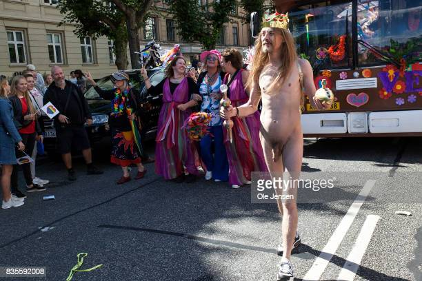 Participants seen at the Copenhagen Pride Parade on August 18 2017 in Copenhagen Denmark The naked man and his entourage depict the fairy tale 'The...