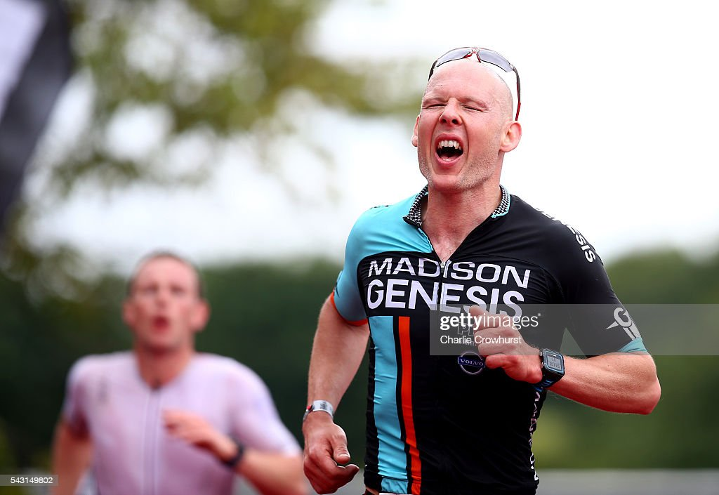 Participants show emotions as the finish the race during the Ironman 70.3 UK at Exmoor National Park on June 26, 2016 in Somerset, England.