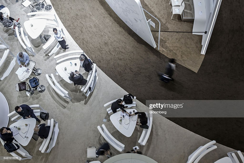 Participants sit at a lounge at the World Economic Forum (WEF) Annual Meeting of the New Champions in Tianjin, China, on Sunday, June 26, 2016. The meeting runs through June 28. Photographer: Qilai Shen/Bloomberg via Getty Images