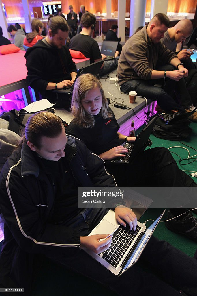 Participants sit at laptop computers as they attend the annual Chaos Communication Congress of the Chaos Computer Club at the Berlin Congress Center on December 28, 2010 in Berlin, Germany. The Chaos Computer Club is Europe's biggest network of computer hackers and its annual congress draws up to 3,000 participants.