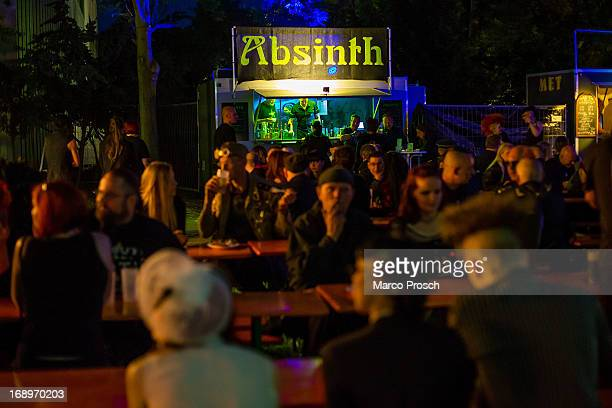 Participants sit in front of a booth selling absinth on the first day of the annual WaveGotik Treffen or Wave and Goth Festival on May 17 2013 in...