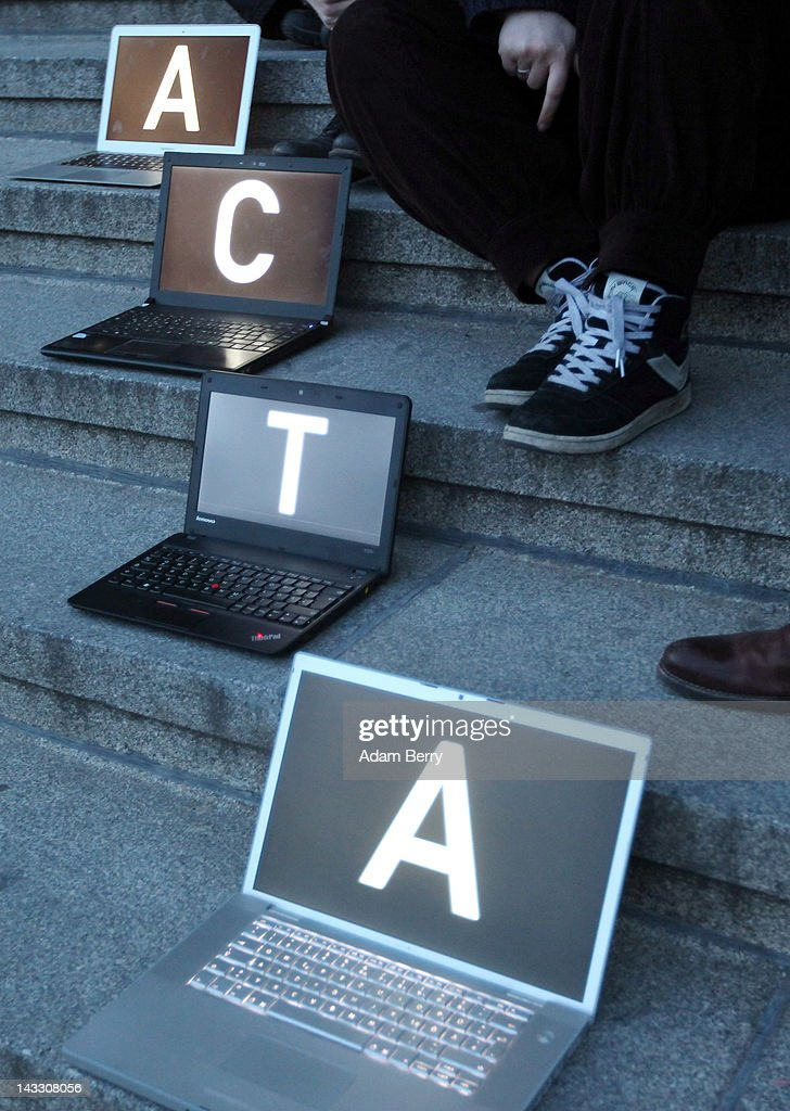 Participants sit with laptop computers featuring screens with letters spelling out the words 'Stop ACTA' during a demonstration against Internet copyright restrictions resulting from the Anti-Counterfeiting Trade Agreement (ACTA) in front of the Altes Museum (Old Museum) on April 23, 2012 in Berlin, Germany. ACTA is a proposed treaty attempting to establish an international governing body with legal standards intended to protect intellectual property and prevent the production and sale of counterfeit goods. The German government has delayed a decision on the agreement, citing concerns by the Justice Ministry, and according to news reports is waiting for approval by the European Parliament prior to signing the multinational treaty.