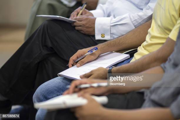 Participants sit with notebooks during a counseling session given by the University of Southern California at the United StatesIndia Education...