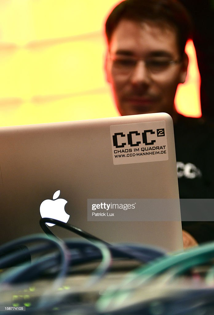 A participants sits behind his laptop at the annual Chaos Computer Club (CCC) computer hackers' congress, called 29C3, on December 28, 2012 in Hamburg, Germany. The 29th Chaos Communication Congress (29C3) attracts hundreds of participants worldwide annually to engage in workshops and lectures discussing the role of technology in society and its future.