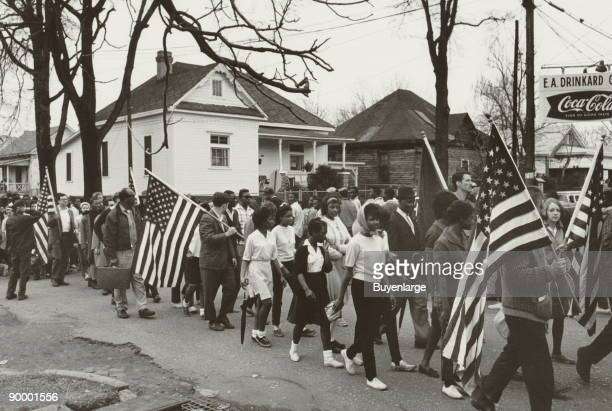 Participants some carrying American flags marching in the civil rights march from Selma to Montgomery Alabama in 1965