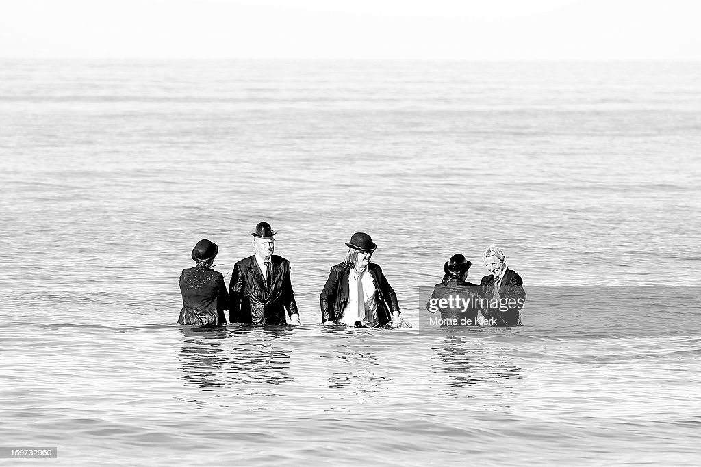 Participants stand in the water after taking part in an art installation created by surrealist artist Andrew Baines on January 20, 2013 in Adelaide, Australia.