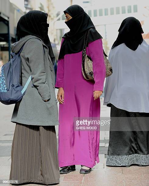 Participants stand silent during a flash mob event in central Sydney on May 17 2010 which called on Muslims and nonMuslims to cover their face with...